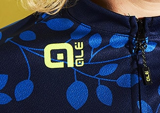 A close up of an exclusive designed jersey from Ale for Wiggle. The jersey is dark blue with light blue leaves.