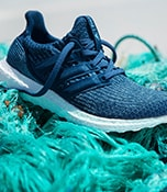 W20 Hero Image - Recycled products - Ultraboost Parley sitting upon some shipping rope