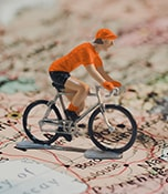 W20 Hero Image - International favourites - Orange Figurine cycling on a map