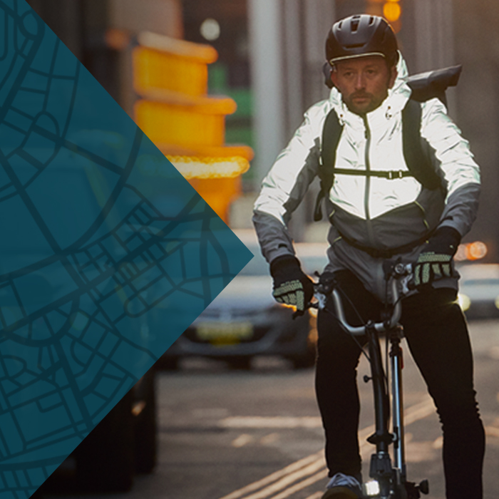A man cycling in the city, wearing the latest Altura autumn winter clothing
