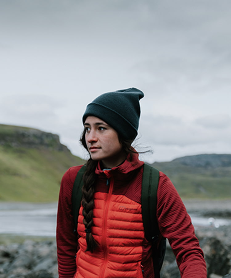 Woman out walking in countryside, wearing Berghaus nula hybrid jacket