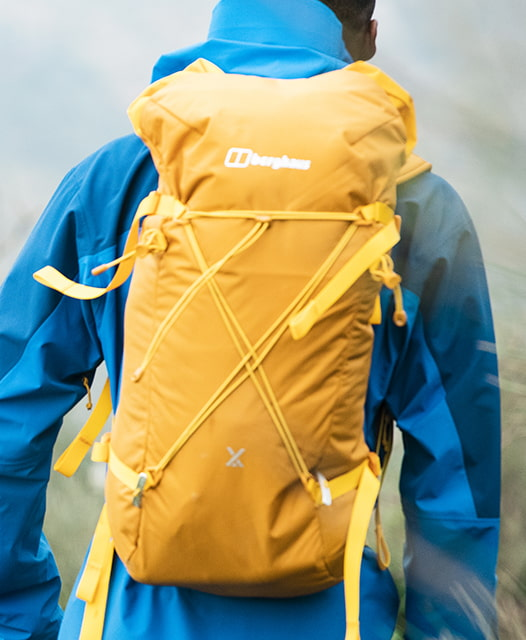 Man wearing a bright yellow Berghaus Rucksack
