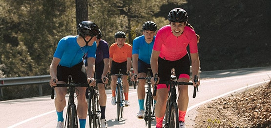 A group of cyclists ride together. Shop D.H.B cycle wear.