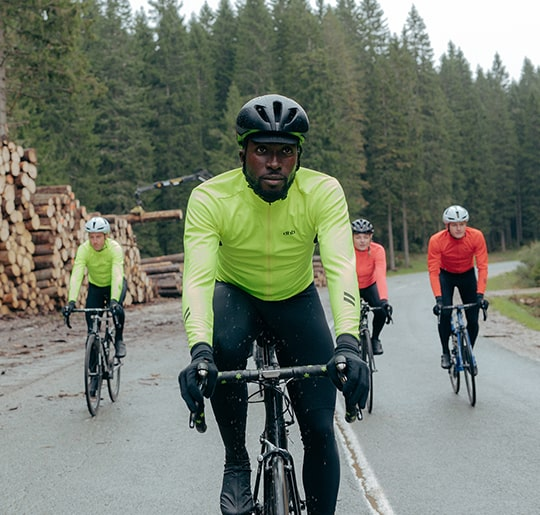 Group of cyclists riding in winter weather, wearing dhb aeron rain defence kit