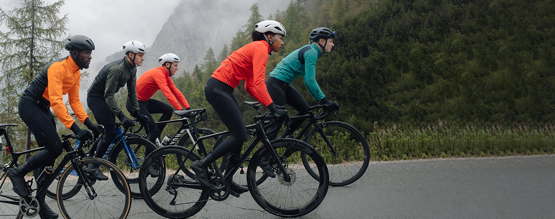 Group of cyclists out riding wearing dhb Aeron cycle kit
