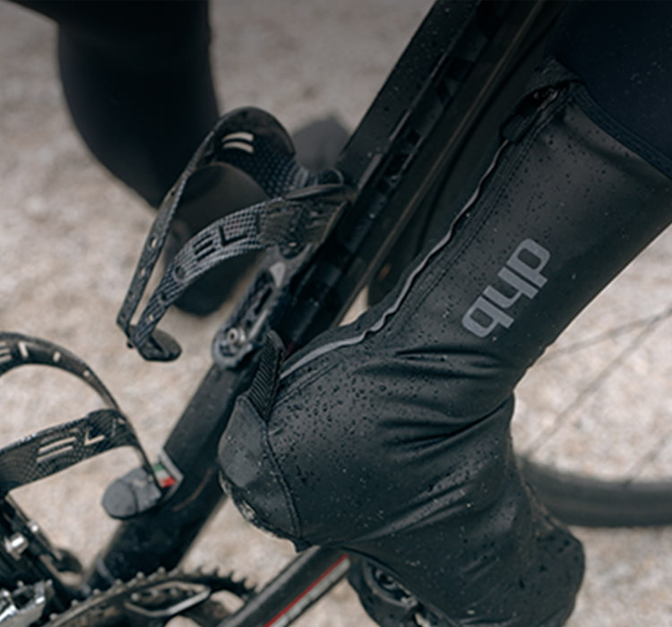 Person out riding wearing dhb cycle overshoe acessories