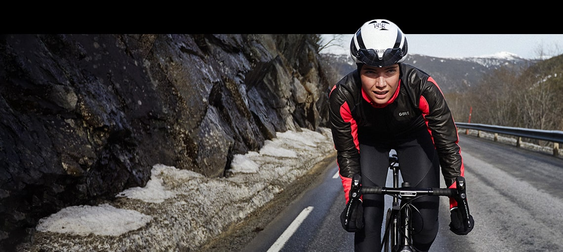 Lady out riding bike wearing the Goretex Shakedry Collection