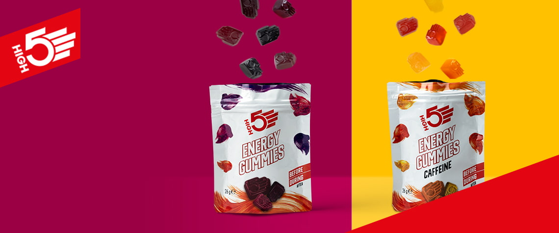 New High 5 energy gummies falling into the packets - berry flavour and tropical caffiene flavour to be taken before/during exercise