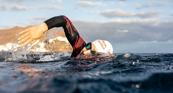 A swimmer swimming in the open sea. Click to see wiggles range of Orca wetsuits.