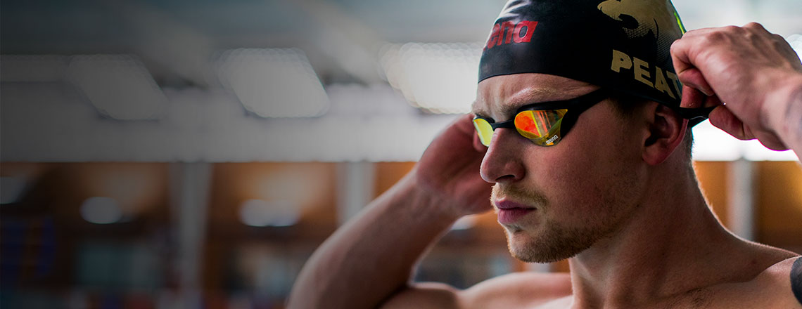 Adam Peaty down the pool in his swim cap and googles, fuelled by SIS