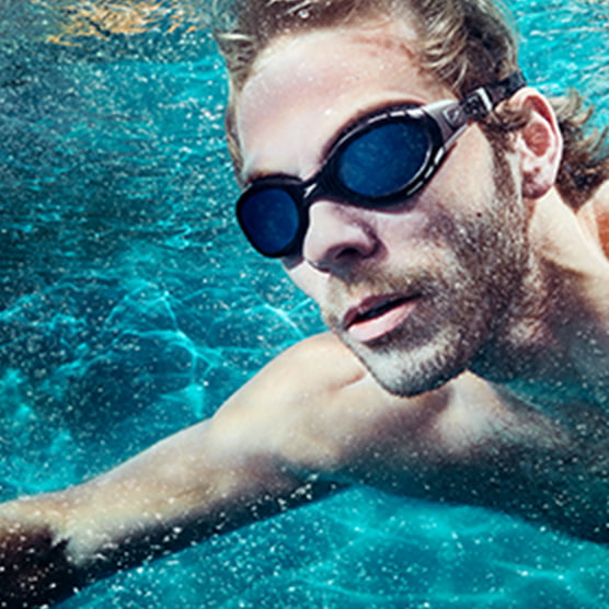 cc5b05477b ACCESSORIES. SHOP NOW · Underwater shot of guy swimming in a pool wearing Speedo  swim shorts ...