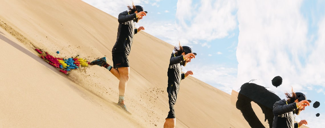 A runner runs down a sand dune, wearing the new stance 2019 collection.