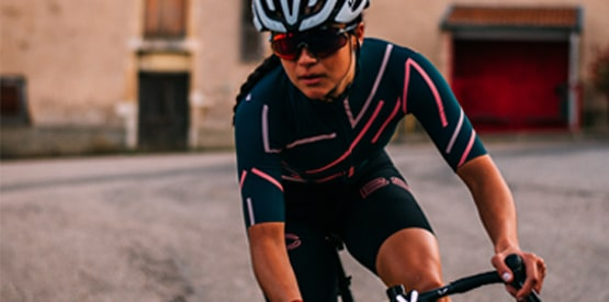 Woman cycling in patterned jersey