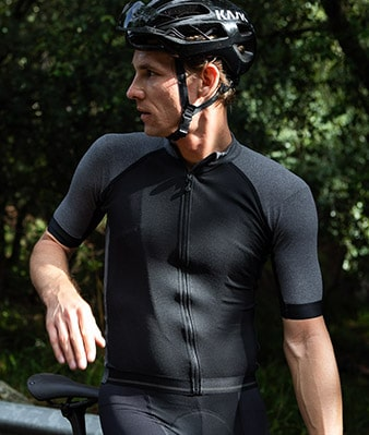 a road cyclist wearing isadore merino collection