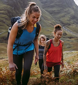 Women walking in a valley wearing berghaus base layers