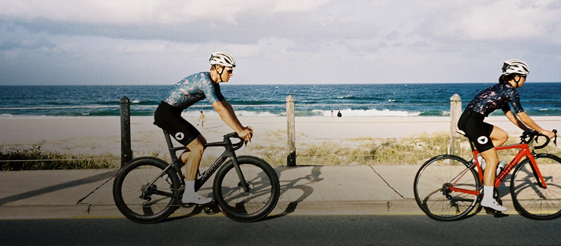 Man and woman cycling in blacksheep clothing