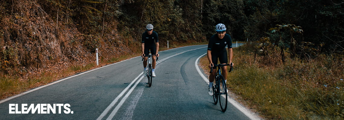 Two cyclists out riding in black and white Black sSheep cycle gear