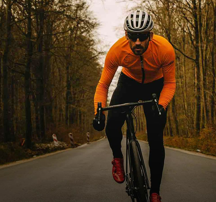 Man out riding in autumn wearing Gore Wear cycle kit
