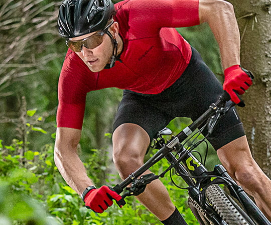 Guy riding mountain bike wearing red gloves