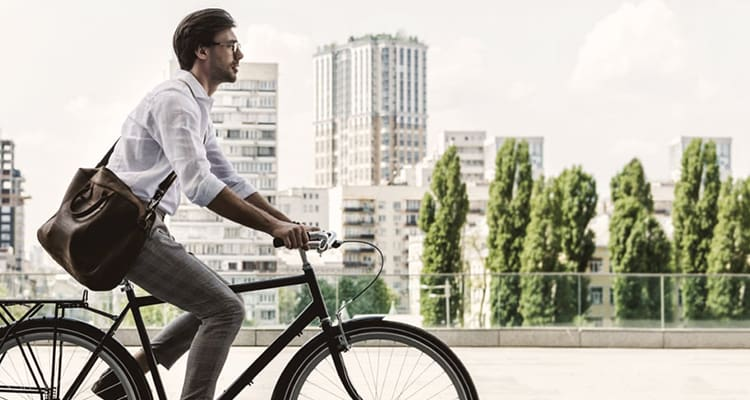 Guy in office attire riding a commuter bike