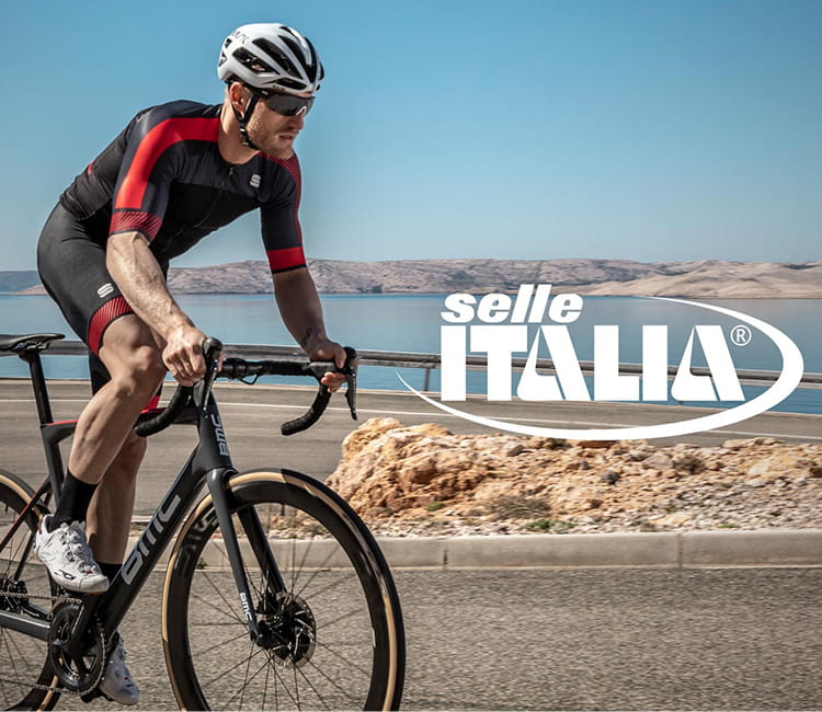 Guy riding bike with Selle Italia Accessories