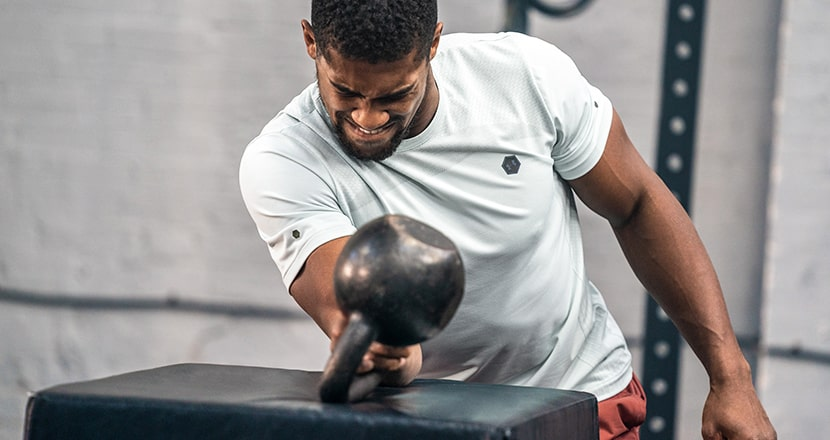 Anthony Joshua lifing weights in the gym wearing Under Armour clothing