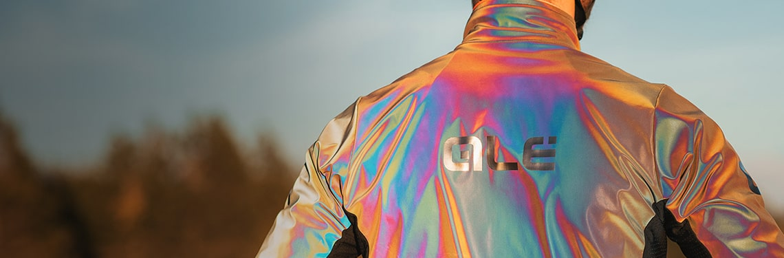 Guy wearing the Ale iridescent reflective jacket