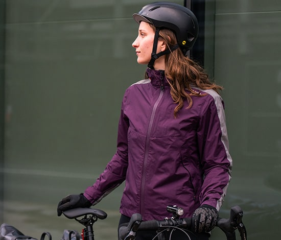 Girl stood by bike in a purple altura jacket