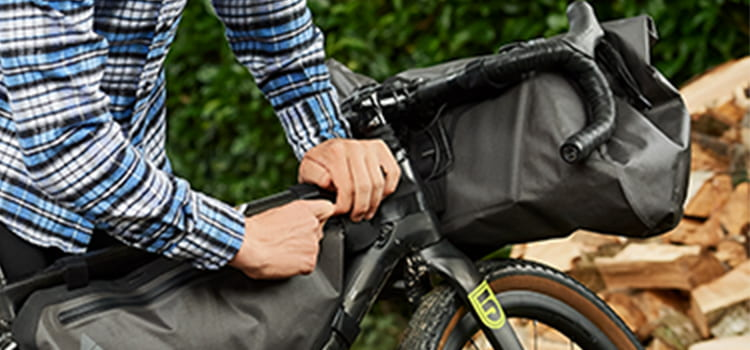 Guy attaching altura luggage storage bags to his bike