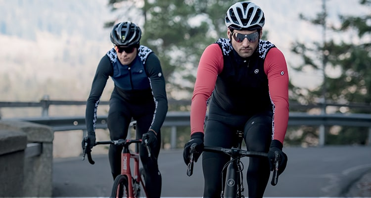Two men out cycling wearing Assos kit