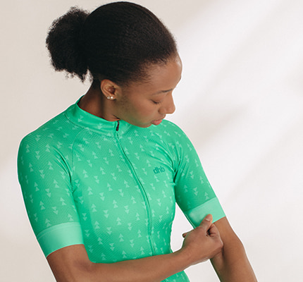 Girl wearing a green patterned dhb aeron jersey