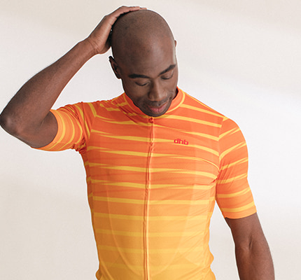 Guy wearing orange and yellow stripey dhb jersey