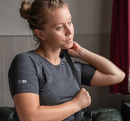 Girl wearing a grey dhb merino top