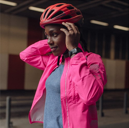 Girl wearing a pink dhb flashlight jacket