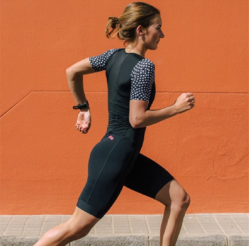 Girl running in a dhb trisuit