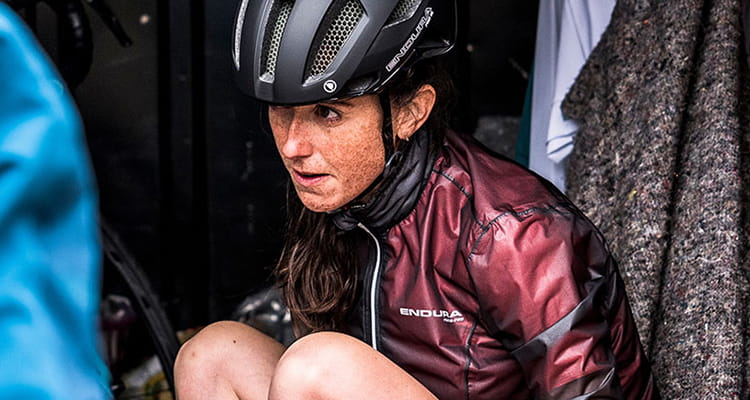 Girl sat in back of van in her Endura cycle gear