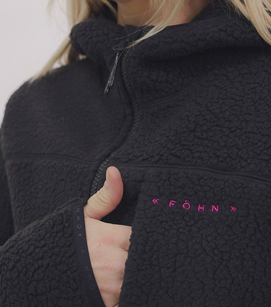 Gril wearing black fohn fleece