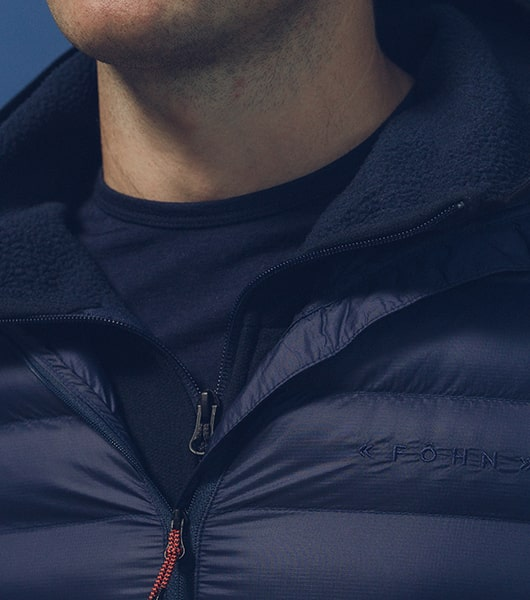 Guy wearing blue fohn insulated jacket