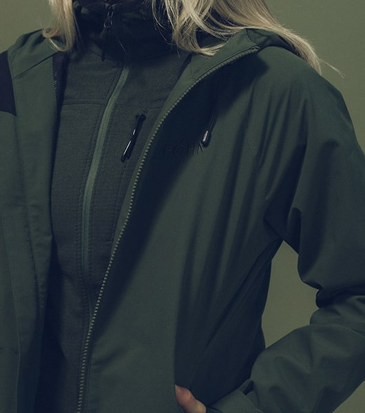 Girl wearing green fohn shell jacket
