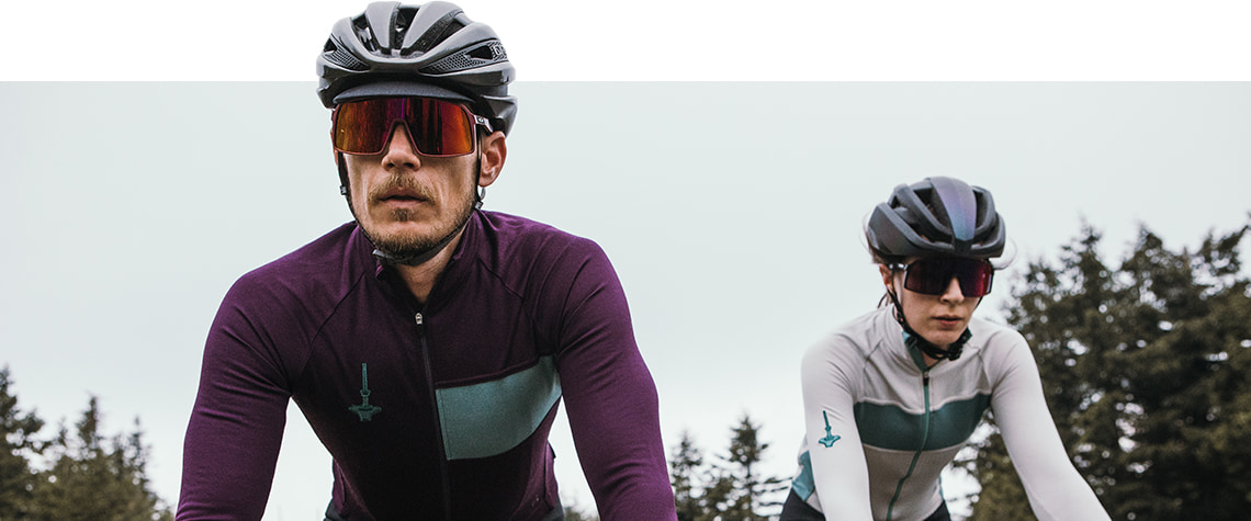 Guy and girl out cycling in Isadore Autumn Winter kit