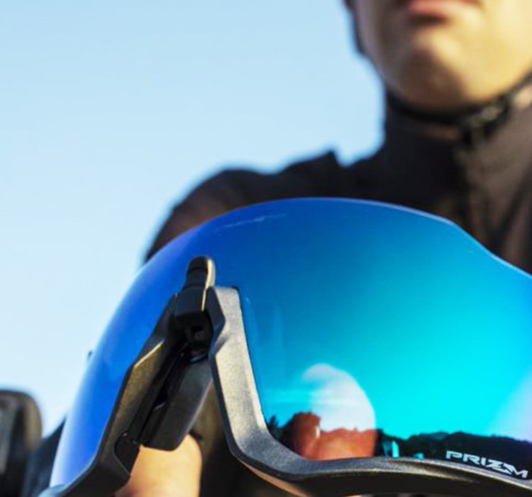 Close up of a guy holding the new Oakley prism road jade lenses