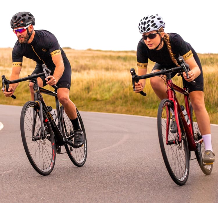 Guy and girl out cycling on their Orro endurance bikes