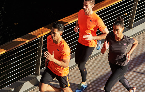 Three people out running, wearing zone3 run compression gear