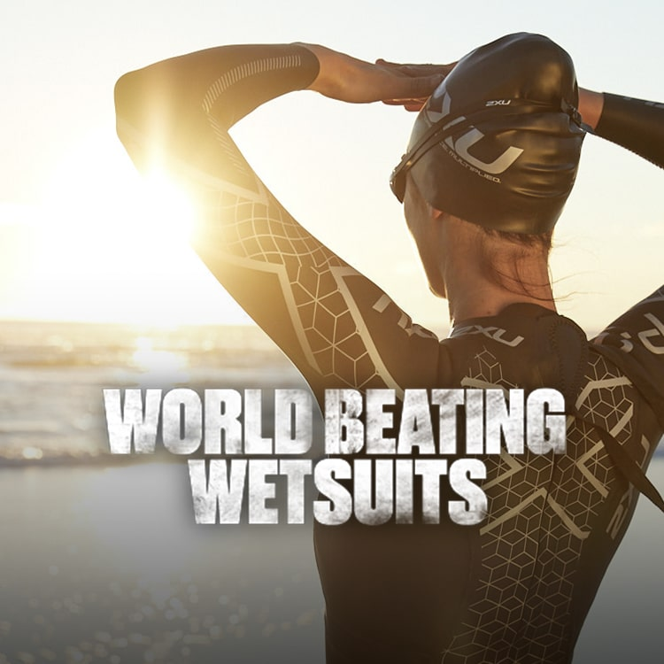 Girl looking out to sea, wearing a 2XU Propel Wetsuit