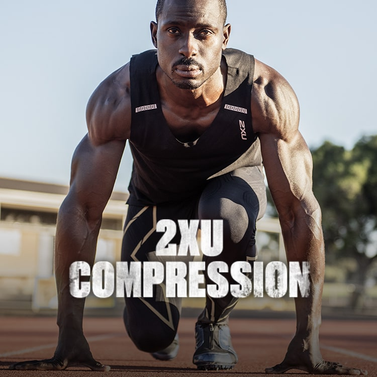 Guy on running track, wearing 2XU compression clothing