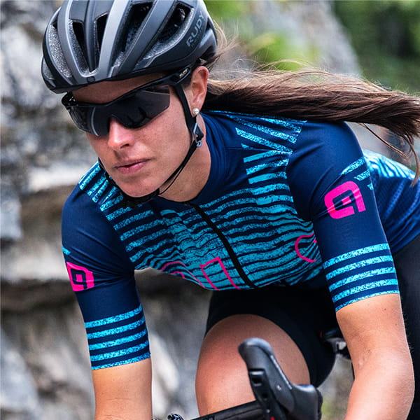 Girl out cycling in a blue patterned Ale jersey