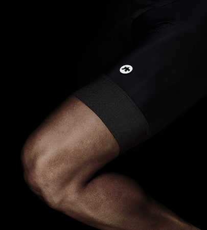 Person wearing black Assos cycle shorts