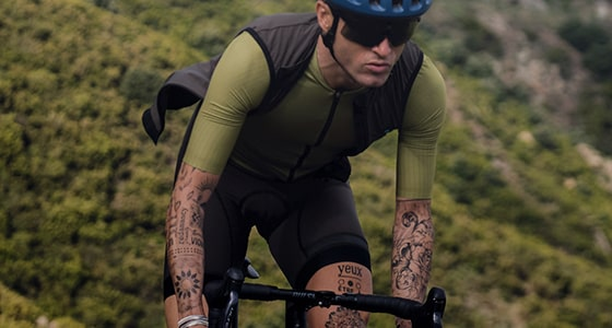Guy out riding in a green Biehler jersey and black gilet