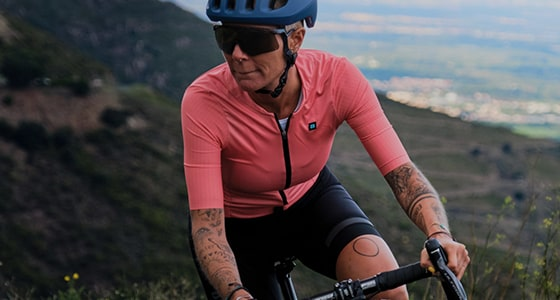 Girl out riding in a pink Biehler jersey