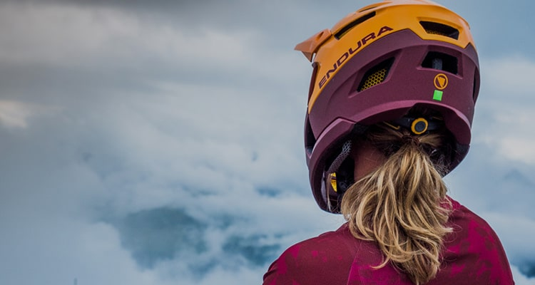 Girl out mountain biking in an Endura mrb helmet